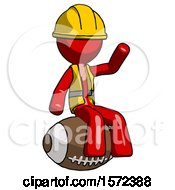 Red Construction Worker Contractor Man Sitting On Giant Football