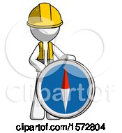 White Construction Worker Contractor Man Standing Beside Large Compass