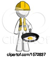 White Construction Worker Contractor Man Frying Egg In Pan Or Wok