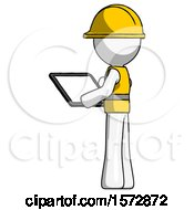 White Construction Worker Contractor Man Looking At Tablet Device Computer With Back To Viewer