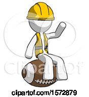 White Construction Worker Contractor Man Sitting On Giant Football
