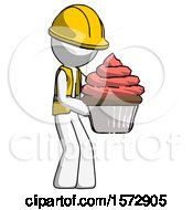 White Construction Worker Contractor Man Holding Large Cupcake Ready To Eat Or Serve
