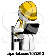 White Construction Worker Contractor Man Using Laptop Computer While Sitting In Chair Angled Right