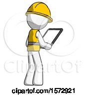 White Construction Worker Contractor Man Looking At Tablet Device Computer Facing Away
