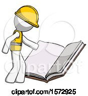 White Construction Worker Contractor Man Reading Big Book While Standing Beside It