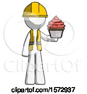 White Construction Worker Contractor Man Presenting Pink Cupcake To Viewer