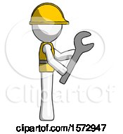 White Construction Worker Contractor Man Using Wrench Adjusting Something To Right