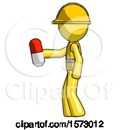 Yellow Construction Worker Contractor Man Holding Red Pill Walking To Left