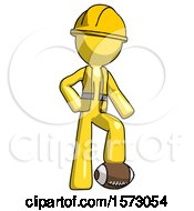 Yellow Construction Worker Contractor Man Standing With Foot On Football