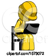 Yellow Construction Worker Contractor Man Using Laptop Computer While Sitting In Chair Angled Right