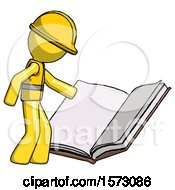 Yellow Construction Worker Contractor Man Reading Big Book While Standing Beside It