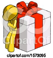 Yellow Construction Worker Contractor Man Leaning On Gift With Red Bow Angle View