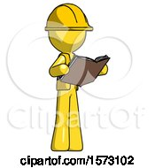 Yellow Construction Worker Contractor Man Reading Book While Standing Up Facing Away