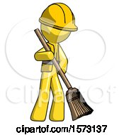 Yellow Construction Worker Contractor Man Sweeping Area With Broom