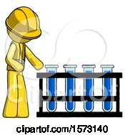 Yellow Construction Worker Contractor Man Using Test Tubes Or Vials On Rack