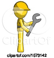 Yellow Construction Worker Contractor Man Using Wrench Adjusting Something To Right