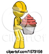 Yellow Construction Worker Contractor Man Holding Large Cupcake Ready To Eat Or Serve