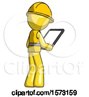 Yellow Construction Worker Contractor Man Looking At Tablet Device Computer Facing Away