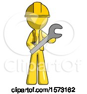 Yellow Construction Worker Contractor Man Holding Large Wrench With Both Hands