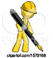 Yellow Construction Worker Contractor Man Drawing Or Writing With Large Calligraphy Pen