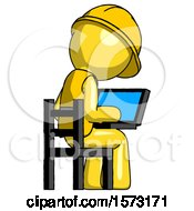 Yellow Construction Worker Contractor Man Using Laptop Computer While Sitting In Chair View From Back