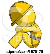 Yellow Construction Worker Contractor Man Sitting With Head Down Facing Sideways Left