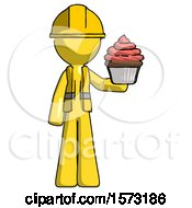 Yellow Construction Worker Contractor Man Presenting Pink Cupcake To Viewer