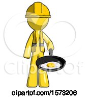 Yellow Construction Worker Contractor Man Frying Egg In Pan Or Wok
