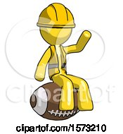Yellow Construction Worker Contractor Man Sitting On Giant Football
