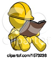 Yellow Construction Worker Contractor Man Reading Book While Sitting Down