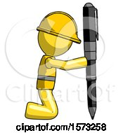 Yellow Construction Worker Contractor Man Posing With Giant Pen In Powerful Yet Awkward Manner