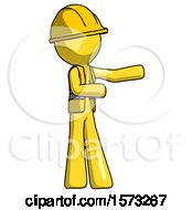 Yellow Construction Worker Contractor Man Presenting Something To His Left