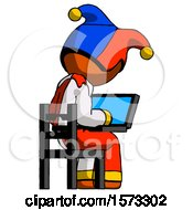 Orange Jester Joker Man Using Laptop Computer While Sitting In Chair View From Back