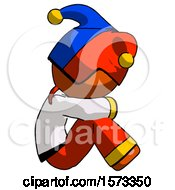 Orange Jester Joker Man Sitting With Head Down Facing Sideways Right