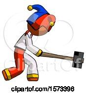Orange Jester Joker Man Hitting With Sledgehammer Or Smashing Something