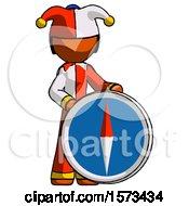 Orange Jester Joker Man Standing Beside Large Compass