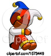 Orange Jester Joker Man Sitting With Head Down Facing Angle Right