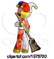Yellow Jester Joker Man Sweeping Area With Broom