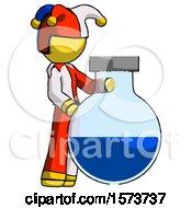 Yellow Jester Joker Man Standing Beside Large Round Flask Or Beaker