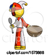 Yellow Jester Joker Man With Empty Bowl And Spoon Ready To Make Something