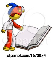 Yellow Jester Joker Man Reading Big Book While Standing Beside It