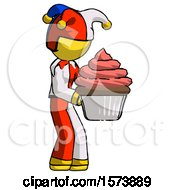 Yellow Jester Joker Man Holding Large Cupcake Ready To Eat Or Serve