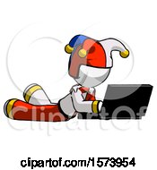 White Jester Joker Man Using Laptop Computer While Lying On Floor Side Angled View