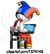 White Jester Joker Man Using Laptop Computer While Sitting In Chair View From Back