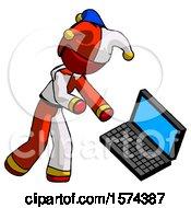 Red Jester Joker Man Throwing Laptop Computer In Frustration