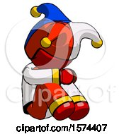 Red Jester Joker Man Sitting With Head Down Facing Angle Right