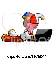 Pink Jester Joker Man Using Laptop Computer While Lying On Floor Side Angled View