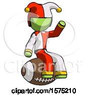 Poster, Art Print Of Green Jester Joker Man Sitting On Giant Football
