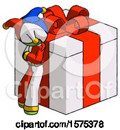 Green Jester Joker Man Leaning On Gift With Red Bow Angle View