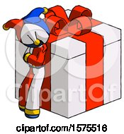 Blue Jester Joker Man Leaning On Gift With Red Bow Angle View